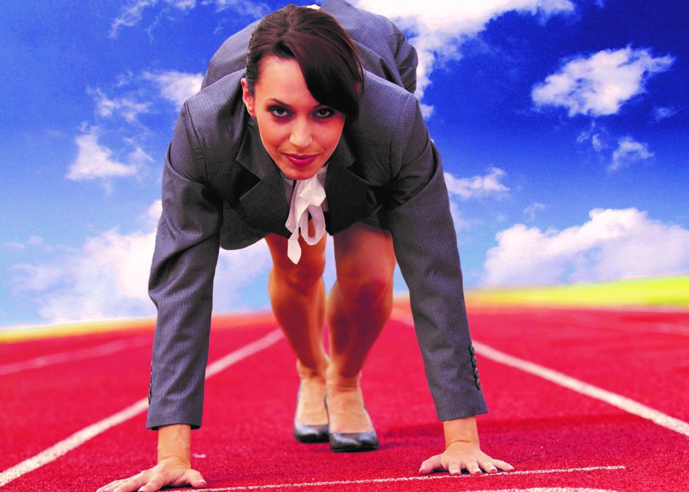 Businesswoman on start line of a running track
